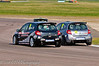 Tom Grice lifts a wheel trying to keep in front of Lee Pattison - Renault Clio Cup UK
