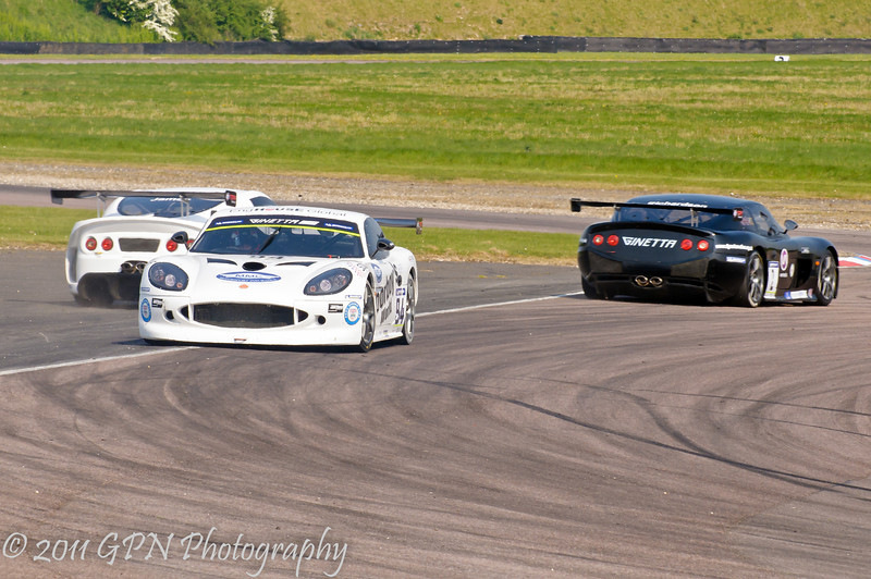 Louise Richardson (Ginetta G50) leads Alistair James (Ginetta G55) while Jake Hill (Ginetta G50) spins - Ginetta GT Supercup
