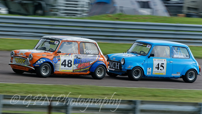 Lee Deegan driving a Mini Miglia 1271 leads Chris Morgan driving a Mini Miglia 1293 in the Dunlop Mini Miglia Challenge race at Thruxton Circuit.
