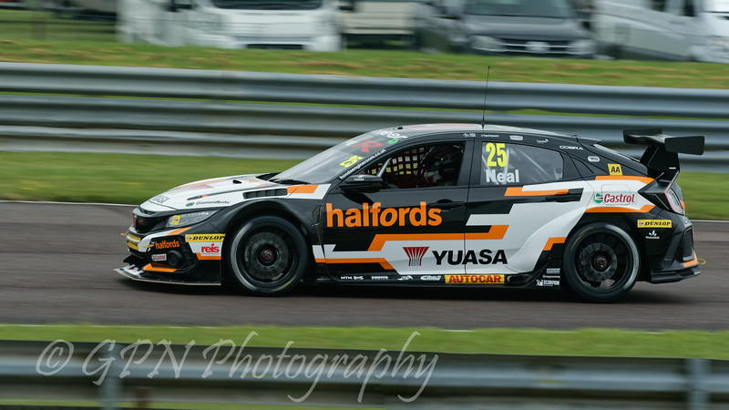 Matt Neal driving the Halfords Yuasa Racing team's Honda Civic Type R in the Kwik Fit British Touring Car Championship at Thruxton Circuit.