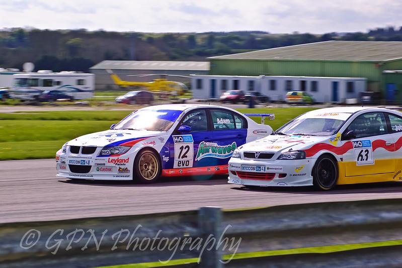 Jonathan Adam (BMW 320si) passing Martin Johnson (Vauxhall Astra Coupe)