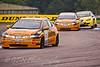 Matt Neal leads his teammate Gordon Shedden (Honda Civic) & Jason Plato (Seat Leon)