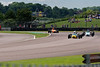 Alex Meek driving a Merlyn Mk20a leads Ben Mitchell driving a Merlyn Mk20 and others in Historic Formula Ford 1600 taken at Thruxton 50th Anniversary Celebration race meeting.