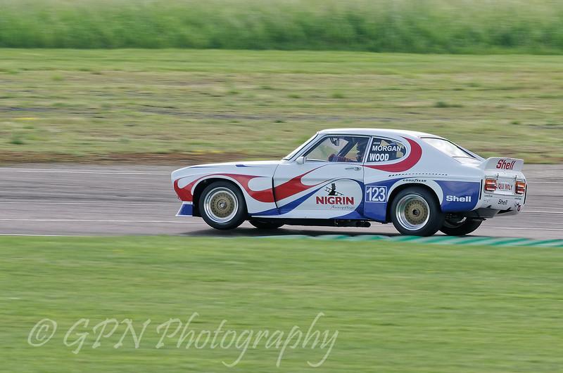 Adam Morgan driving a class HT2C Ford Capri taken at Thruxton 50th Anniversary Celebration race meeting.