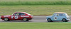 Nick Riley driving a class TDT INV Austin Cooper S chasing Paul Chase-Gardner driving a class TD2C Ford Capri taken at Thruxton 50th Anniversary Celebration race meeting.
