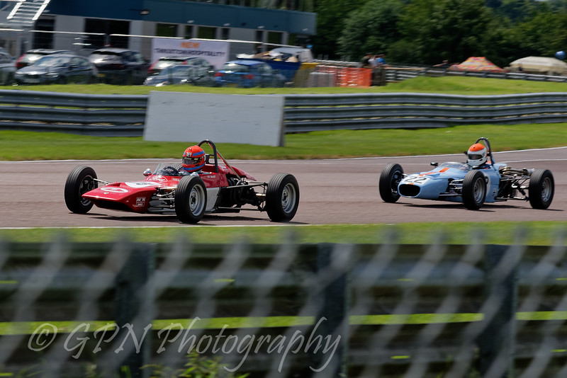 Tiff Needell driving a Lotus 69F leads Tim Brise driving a Merlyn Mk20 Historic Formula Ford 1600 taken at Thruxton 50th Anniversary Celebration race meeting.