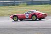 Johan Denekamp driving a Class A Marcos 1800GT taken at Thruxton 50th Anniversary Celebration race meeting.