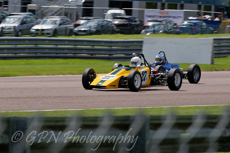 Dick Dixon driving a Lotus 61 passes a rival in Historic Formula Ford 1600 taken at Thruxton 50th Anniversary Celebration race meeting.