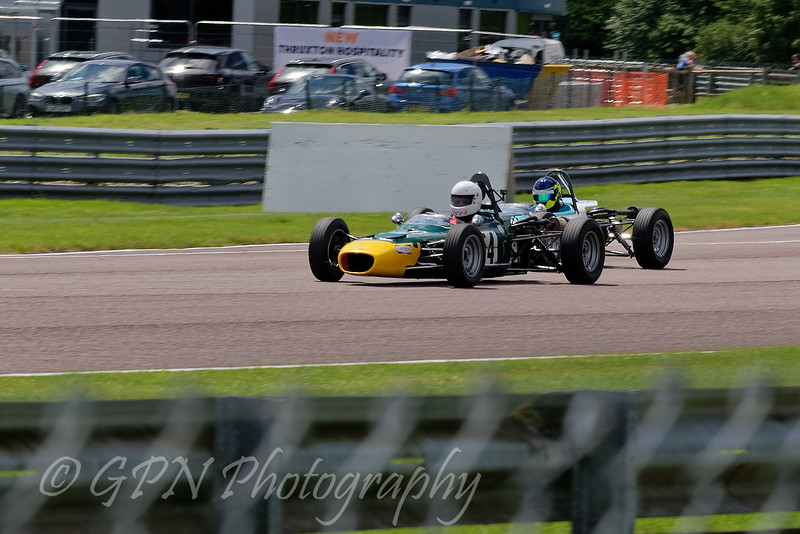 Alex Meek driving a Merlyn Mk20a passes a rival in Historic Formula Ford 1600 taken at Thruxton 50th Anniversary Celebration race meeting.