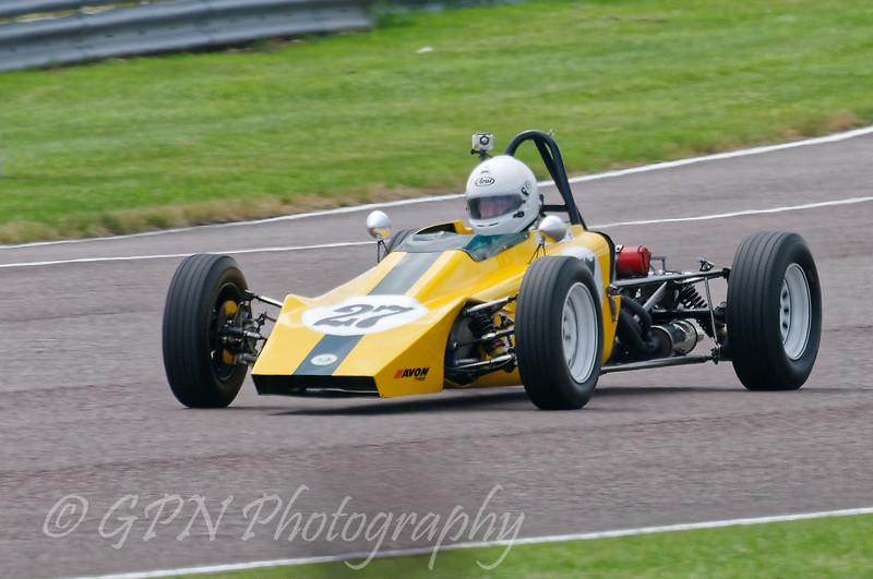 Dick Dixon driving a Class OF FF1600 Lotus 61 taken at Thruxton 50th Anniversary Celebration race meeting.