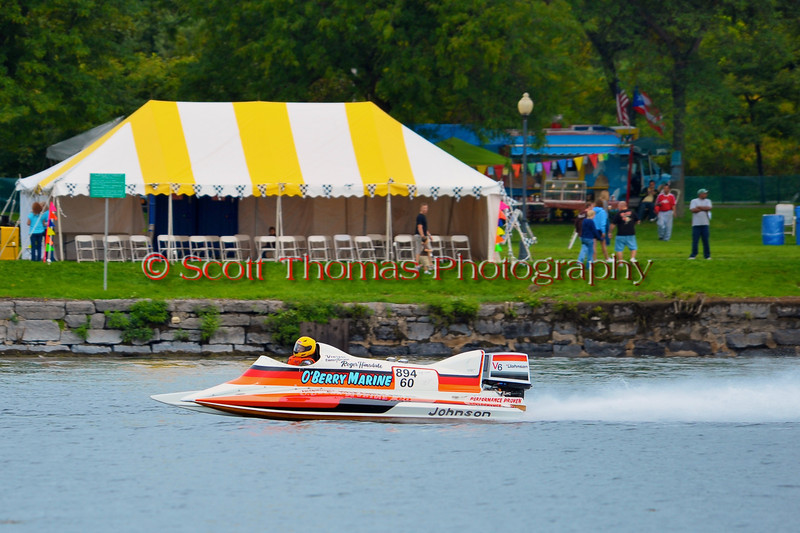 Vintage racing boats doing fly-bys at the HydroBowl on Seneca Lake  in Geneva, New York.
