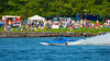 Fans watch a Grand National Hydro (GNH) boat fly by at the HydroBowl on Seneca Lake Inboard Hydroplane Racing in Geneva, New York.