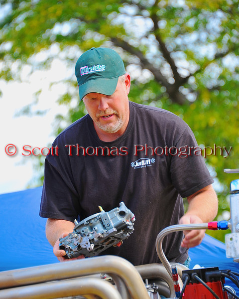 Driver/Owner Keith McKnight of Cortland, New York readies his National Modifed (NM-32) All Jacked Up in the pits at the HydroBowl on Seneca Lake in Geneva, New York.