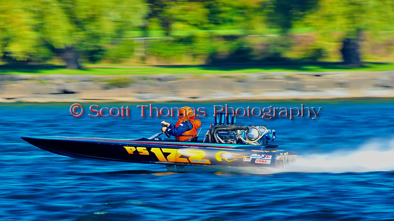 Dominic Cournoyer driving the Can Am-122 Blue Thunder Pro Stock Inboard Racing Runabout at speed during the HydroBowl on Seneca Lake in Geneva, New York.