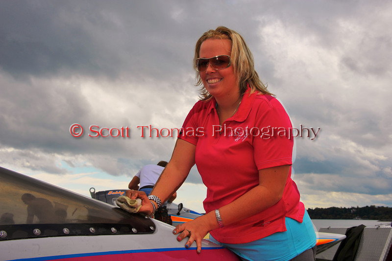 Caroline Daoust, driver of the Inboard Hydroplane CS-9/H-9 The Dog, cleans off the boat's windshield while in the  pits at the HydroBowl on Seneca Lake in Geneva, New York.
