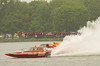 Hydroplane GP777 The Crush being driven by Patrick Haworth passes  GP93 Renegade being driven by Marty Wolfe during the first Grand Prix class heat at Syracuse Hyrdofest on Saturday, June 20, 2009.