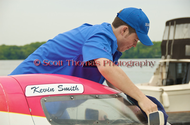 Driver Kevin Smith working on his T26 Dream Weaver, a 1.5 liter stock hydroplane, at the Syracuse Hydrofest on Saturday, June 20, 2009.