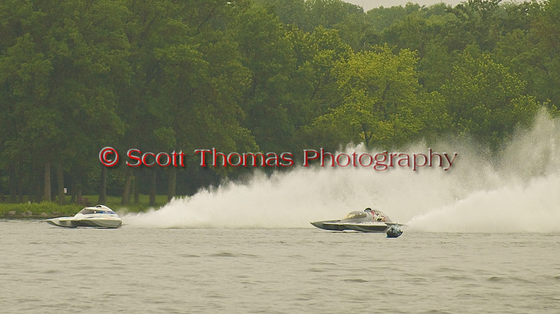Rolling Thunder (GP88 on the left) and Miss Dinomytes (GP46) race past the Start/Finish line during the Grand Prix Hyrdroplane heat during the Syracuse Hydrofest on Saturday, June 20. 2009.