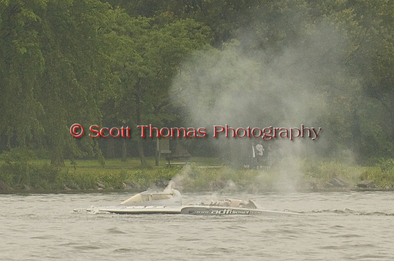 This is the Grand Prix hydroplane boat GP46 Miss Dinomytes driven by Pierre Maheu from Quebec that got ran over by the Long Gone driven by Jimmy Shane of Maryland.  The Miss Dinomytes is missing the 1200HP engine which is now at the bottom of Onondaga Lake.  The driver was unconscious for about 20 minutes.  Both drivers are reported to be in good condition at a Syracuse hospital. Taken during the Syracuse Hyrdrofest on Saturday, June 20, 2009.