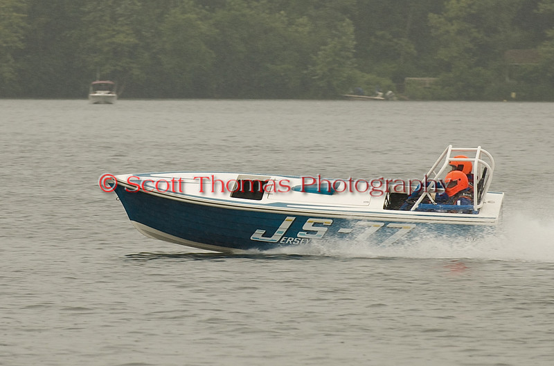 Jersey Speed Skiff JS-77 takes a demonstration lap before racing starts at the Syracuse Hyrdrofest on Saturday, June 20, 2009.