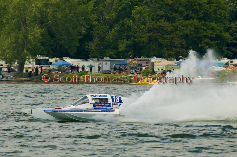 Grand National Hydro  hydroplane Magnum (GNH-18) driven by George L. Conover Sr. on the course at the 2010 Syracuse Hydrofest  held at Onondaga Lake Park near Liverpool, New York on Saturday, June 19.