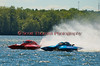 5.0 Liter Stock hydroplanew Team Shane (CE-77) and Willy's Pub (CD-104) race down the backstretch at the 2010 Syracuse Hydrofest held at Onondaga Lake Park near Liverpool, New York on Sunday, June 20.