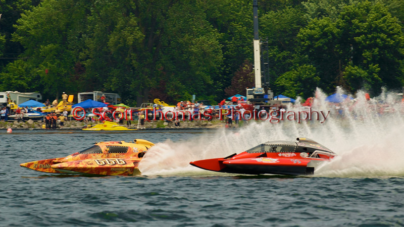 5.0 Liter Stock hydroplanes El Diablo (CE-666) and OCR Race Team (CE-99) race down the front stretch at the 2010 Syracuse Hydrofest. 5.0 Liter Stock hydroplanes can reach speeds of 115mph.