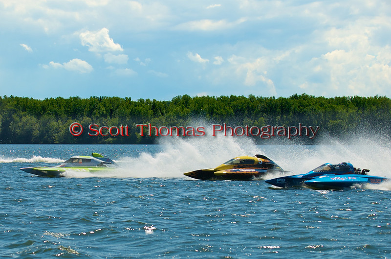 Hydroplanes Adrenaline Rush (CE-13), Canadian Tire Valleyfield (CD-5) and Willy's Pub (CE-104) jockeying for lanes before a 5.0 Liter Stock heat race at the 2010 Syracuse Hydrofest held at Onondaga Lake Park near Liverpool, New York on Sunday, June 20.