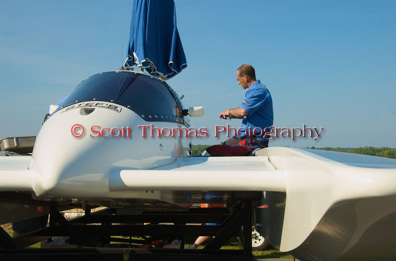 Crewmember working on a hydroplane in the pits at the 2010 Syracuse Hydrofest held at Onondaga Lake Park near Liverpool, New York on Saturday, June 19.