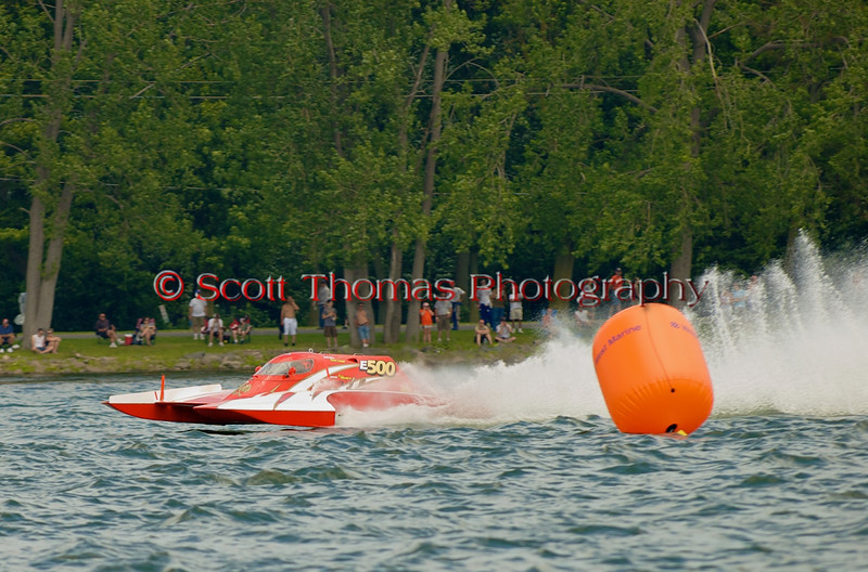 5.0 Liter Stock hydroplane Centsless 14 (CE-500) driven by Keith Joslyn rounds turn one at the 2010 Syracuse Hydrofest  held at Onondaga Lake Park near Liverpool, New York on Saturday, June 19.