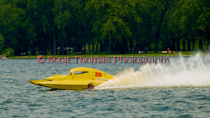 5.0 Liter Stock hydroplane Big Bird (E-30) driven by Mark Johnson on the course at the 2010 Syracuse Hydrofest  held at Onondaga Lake Park near Liverpool, New York on Saturday, June 19.