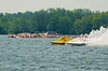 National Modified  hydroplanes Big Bird (NM-30) and Illusion(NM-928) race side by side as spectators watch from their boats at the 2010 Syracuse Hydrofest  held at Onondaga Lake Park near Liverpool, New York on Saturday, June 19.