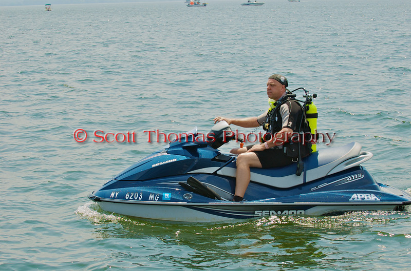 Rescue diver on his Sea Doo craft ready to help a hydroplane driver at the Syracuse Hydrofest 2010 held at Onondaga Lake Park near Liverpool, New York on Saturday, June 19.