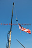 A crane from the JPW Companies lowers the American flag before hoisting hydroplanes into Onondaga Lake for the 2010 Syracuse Hydrofest held at Onondaga Lake Park near Liverpool, New York on Saturday, June 19.