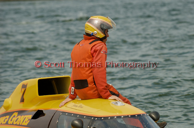 Driver Jimmy Shane of the disabled Grand Prix  hydroplane Long Gone (GP-7) sits and watches as he waits to be towed back to the pits at the 2010 Syracuse Hydrofest  held at Onondaga Lake Park near Liverpool, New York on Saturday, June 19.