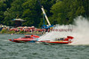 Grand Prix  hydroplanes The Crush 2 (GP-77) and Valleyfield (GP-444) battle it out during a heat race at the 2010 Syracuse Hydrofest  held at Onondaga Lake Park near Liverpool, New York on Saturday, June 19.