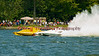 National Modified hydroplanes Big Bird (NM-30) and Illusion (NM-928) race down the front stretch in front of fans at the 2010 Syracuse Hydrofest held at Onondaga Lake Park near Liverpool, New York on Saturday, June 19.