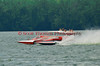 5.0 Liter Stock hydroplanes Team Extreme E-97 and Centsless 14 E-500 racing side by side at the 2010 Syracuse Hydrofest  held at Onondaga Lake Park near Liverpool, New York on Saturday, June 19.