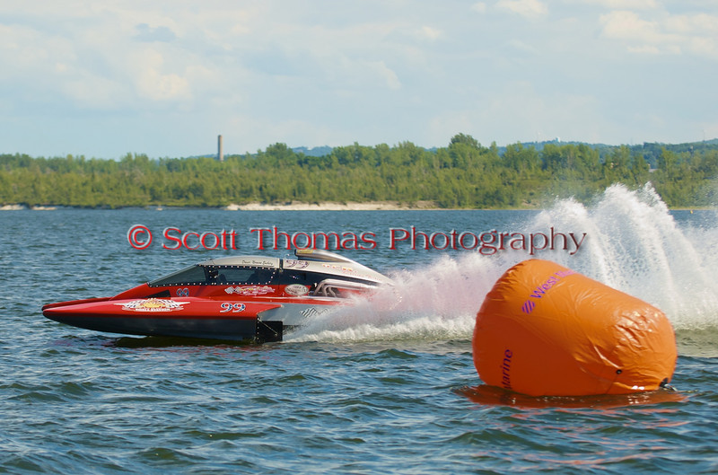 5.0 Liter Stock hydroplane OCR Race Team (CE-99) driven by Norman Ensbury on the course at the 2010 Syracuse Hydrofest held at Onondaga Lake Park near Liverpool, New York on Sunday, June 20.