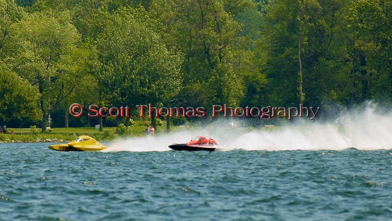 5.0 Liter Stock hydroplanes Team Extreme (E-97) and Big Bird (E-30) racing side by side at the 2010 Syracuse Hydrofest  held at Onondaga Lake Park near Liverpool, New York on Saturday, June 19.
