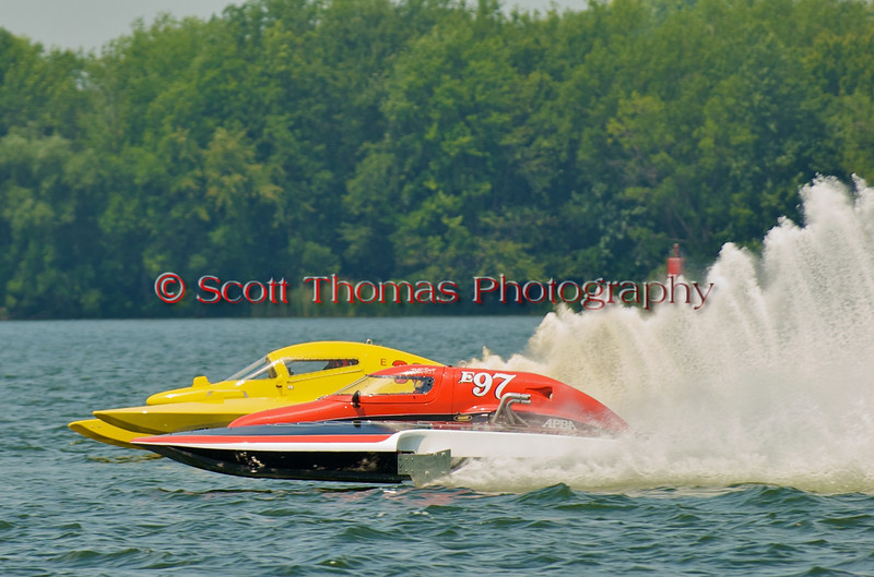 5.0 Liter hydroplanes Big Bird (E-30, yellow) and Team Extreme (E-97) in close racing during the 2010 Syracuse Hydrofest  held at Onondaga Lake Park near Liverpool, New York on Saturday, June 19.