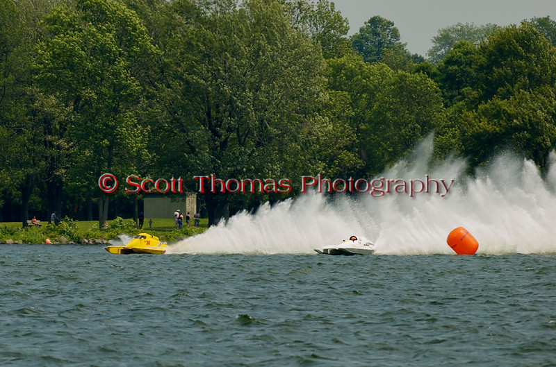 National Modified  hydroplanes Big Bird (NM-30) and Illusion(NM-928) race side by side at the 2010 Syracuse Hydrofest  held at Onondaga Lake Park near Liverpool, New York on Saturday, June 19.