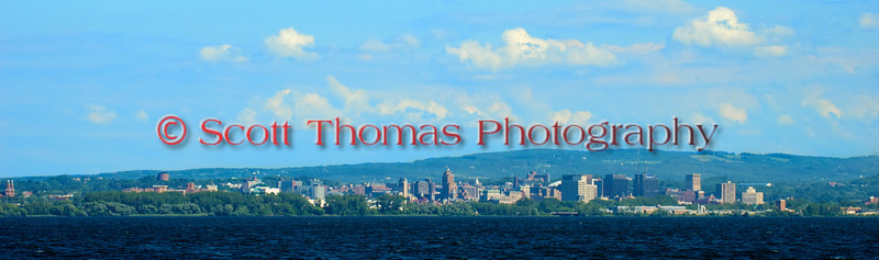 Panoramic crop of the City of Syracuse's skyline from an official's boat out on the course of the 2010 Syracuse Hydrofest held at Onondaga Lake Park near Liverpool, New York on Sunday, June 20.