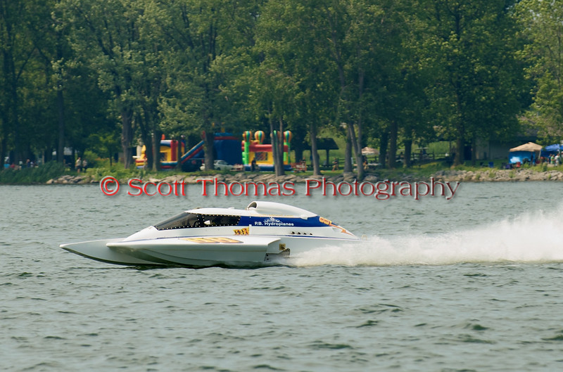 Grand Prix  hydroplane Rolling Thunder (GP-88) driven by Tom Pakradooni on the course at the 2010 Syracuse Hydrofest  held at Onondaga Lake Park near Liverpool, New York on Saturday, June 19.