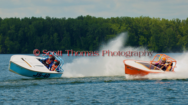 The Jersey Skiffs, JS-40 and JS-100 (orange hull), race side by side into a turn at Syracuse Hyrdofest on Sunday, June 20, 2010.