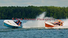 The Jersey Skiffs, JS-40 and JS-100 (orange hull), race side by side into a turn at Syracuse Hyrdofest on Sunday, June 20, 2010.