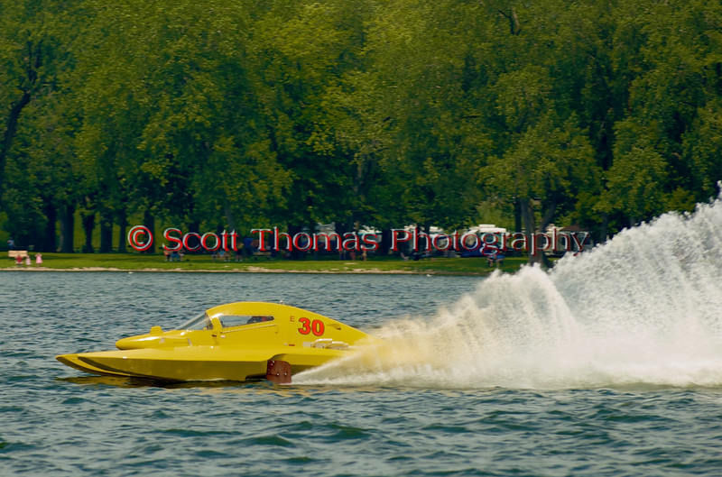 5.0 LIter Stock hydroplane Big Bird (E-30) out of Cinnaminson, New Jersey and driven by Mark Johnson on the race course cruising at speeds close to 100mph during Syracuse Hydrofest 2010 held at Onondaga Lake Park near Liverpool, New York on Saturday, June 19.