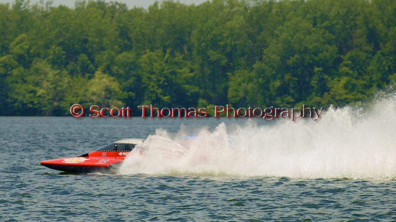 5.0 Liter Stock hydroplane nnnnnnnn (CE-99) driven by nnnnnnnnnnnn on the course at the 2010 Syracuse Hydrofest  held at Onondaga Lake Park near Liverpool, New York on Saturday, June 19.