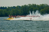 National Modified  hydroplanes NM-710 and Illusion (NM-928) race side by side as spectators watch from their boats at the 2010 Syracuse Hydrofest  held at Onondaga Lake Park near Liverpool, New York on Saturday, June 19.