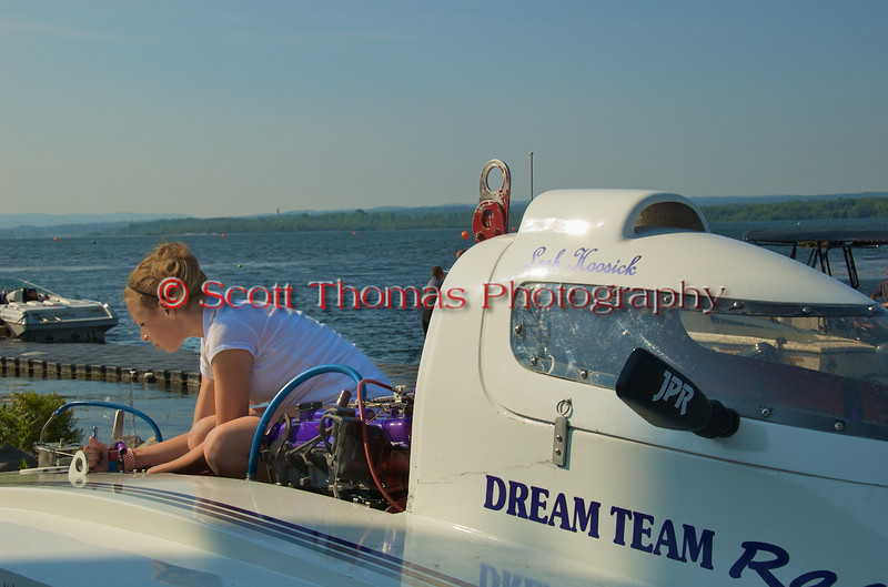 Driver Leah Hoosick works on her 1.5 Liter Stock Chaotic Dream (T-27) hydroplane. Syracuse Hydrofest 2010 held at Onondaga Lake Park near Liverpool, New York on Saturday, June 19.